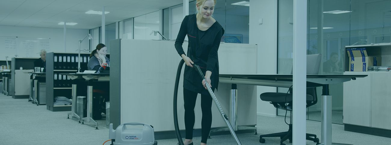 Image of a Woman Cleaning an Office